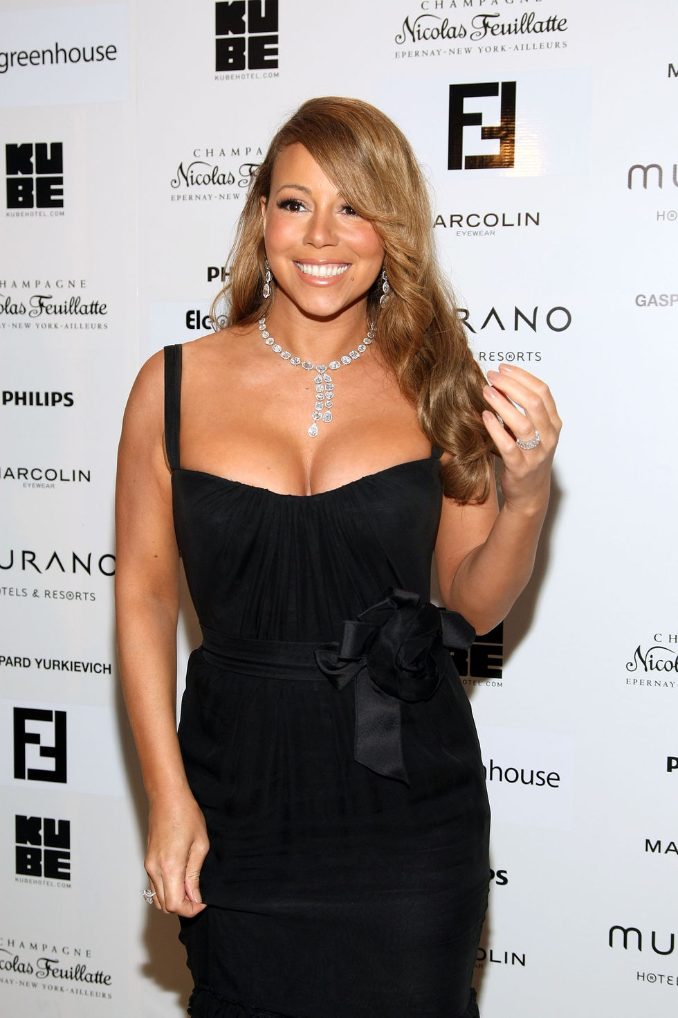 mariah-carey-cleavage-candids-at-murano-house-in-cannes-01