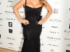 mariah-carey-cleavage-candids-at-murano-house-in-cannes-06