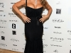 mariah-carey-cleavage-candids-at-murano-house-in-cannes-10