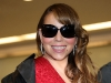 mariah-carey-in-red-revealing-dress-at-narita-airport-20
