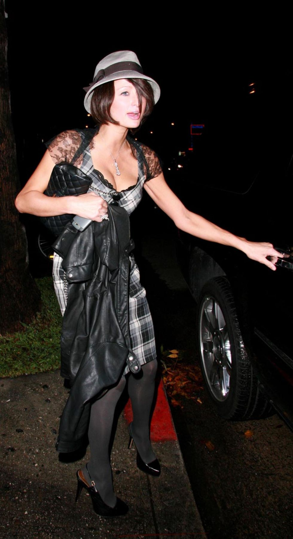 paris-hilton-cleavagy-candids-at-falcon-club-in-hollywood-01