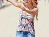 sophie-monk-leggy-with-downblouse-at-the-beach-02