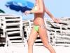 tara-reid-green-bikini-candids-on-the-beach-in-miami-07