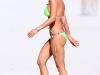 tara-reid-green-bikini-candids-on-the-beach-in-miami-08