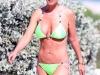 tara-reid-green-bikini-candids-on-the-beach-in-miami-12